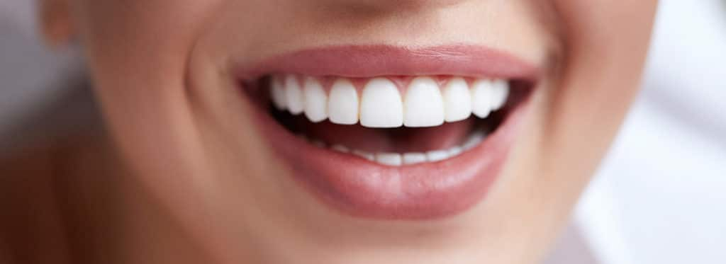 Cosmetic Dental Care Can Improve Oral Health Featured Image - Marx Family Dental